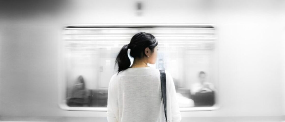 personal branding on social media - why motivation isn't everything - woman standing in a metro station